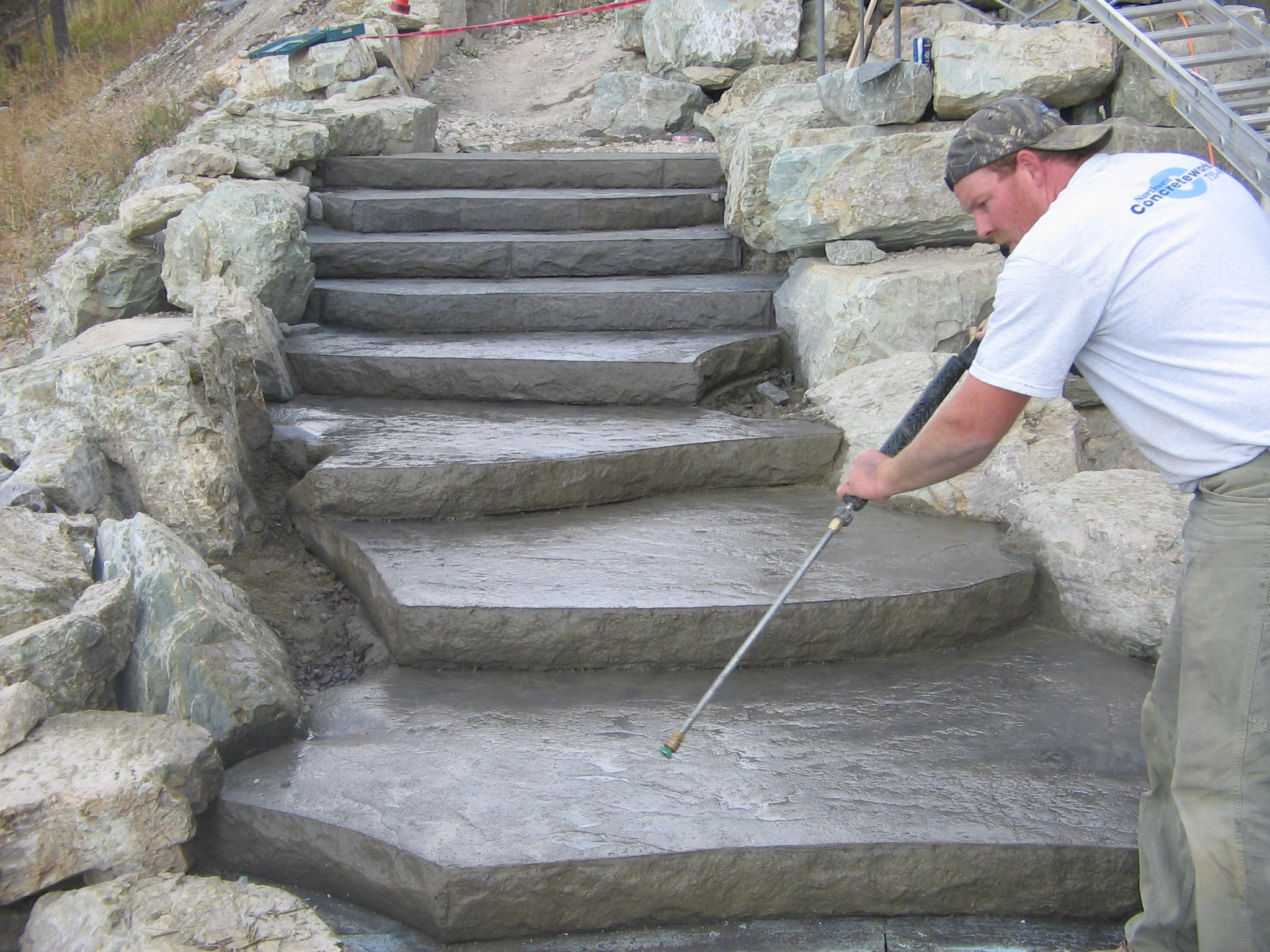 Nw concreteworks inc concrete patios sidewalks and for Pictures of stone steps